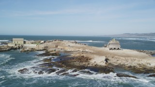 DFKSF15_104 - 5K stock footage aerial video of flying by abandoned buildings, seals and sea lions on Año Nuevo Island, California