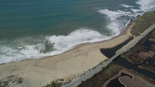 DFKSF15_110 - 5K stock footage aerial video flyby the Highway 1 coastal road, revealing a beach, Davenport, California