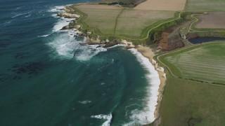 DFKSF15_118 - 5K stock footage aerial video of flying away from coastal cliffs, Santa Cruz, California