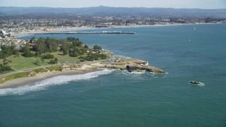DFKSF15_127 - 5K stock footage aerial video of tilt from kelp forests to reveal coastal neighborhoods and Santa Cruz Wharf, Santa Cruz, California