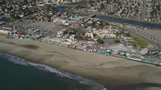 DFKSF15_131 - 5K stock footage aerial video of tilting from the ocean to reveal roller coaster at Santa Cruz Beach Boardwalk, California