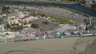 DFKSF15_132 - 5K stock footage aerial video of a roller coaster at the Santa Cruz Beach Boardwalk, Santa Cruz, California