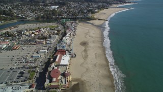 DFKSF15_134 - 5K stock footage aerial video of orbiting the beach and rides at Santa Cruz Beach Boardwalk, Santa Cruz, California