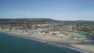 DFKSF15_138 - 5K stock footage aerial video of flying away from Santa Cruz Beach Boardwalk and coast, Santa Cruz, California