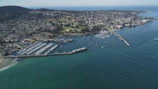 DFKSF16_004 - 5K stock footage aerial video approach Monterey Fisherman's Wharf and coastal neighborhoods in Monterey, California