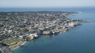 DFKSF16_005 - 5K stock footage aerial video approach coastal residential neighborhoods and Monterey Bay Aquarium, Monterey, California