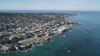 DFKSF16_006 - 5K stock footage aerial video tilt to reveal coastal neighborhoods and Monterey Bay Aquarium, Monterey, California