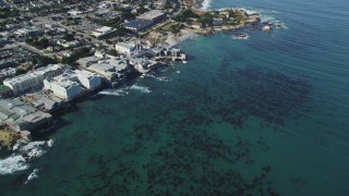 DFKSF16_007 - 5K stock footage aerial video tilt from kelp to reveal coastal neighborhoods and Monterey Bay Aquarium, Monterey, California