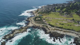 DFKSF16_012 - 5K stock footage aerial video tilt from coast to reveal Point Pinos Lighthouse Reservation, Monterey, California