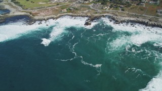 DFKSF16_013 - 5K stock footage aerial video tilt from the ocean, reveal Point Pinos Lighthouse Reservation, Monterey, California
