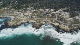 DFKSF16_014 - 5K stock footage aerial video of flying by coastal homes on Sunset Drive, Pacific Grove, California