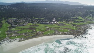 DFKSF16_015 - 5K stock footage aerial video of flying by a coastal resort and golf course, Pebble Beach, California