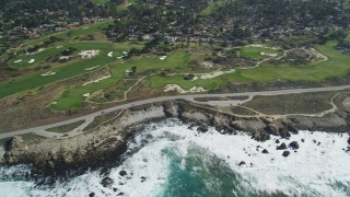 DFKSF16_017 - 5K stock footage aerial video of 17 Mile Drive coastal road and golf course near homes in Pebble Beach, California