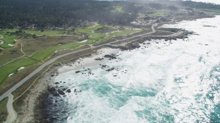 DFKSF16_018 - 5K stock footage aerial video of a coastal road and golf course in Pebble Beach, California