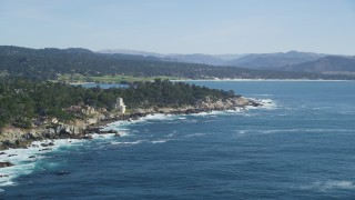 DFKSF16_024 - 5K stock footage aerial video of flying by oceanfront mansions on the coast in Pebble Beach, California