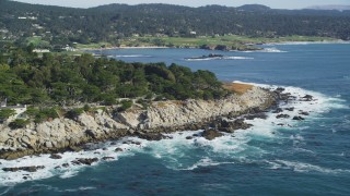 DFKSF16_026 - 5K stock footage aerial video of flying by oceanfront homes and coastline, Pebble Beach, California