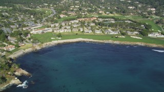 DFKSF16_032 - 5K stock footage aerial video tilt from Carmel Bay, reveal a resort hotel and golf course, Pebble Beach, California