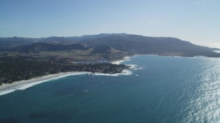 DFKSF16_038 - 5K stock footage aerial video of flying over Carmel Bay, pan over beaches, beachfront homes, Carmel, California