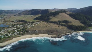 DFKSF16_039 - 5K stock footage aerial video tilt from Carmel Bay revealing Carmel State Beach and homes, Carmel, California