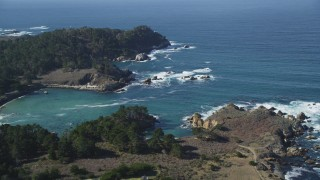 DFKSF16_043 - 5K stock footage aerial video of tilting from a coastal highway to reveal Whalers Cove, Carmel, California