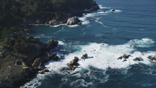 DFKSF16_044 - 5K stock footage aerial video of tilting from the coves along the coast to reveal coastal cliffs, Carmel, California