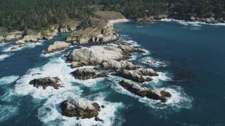 DFKSF16_048 - 5K stock footage aerial video of flying by coastal rock formations, Carmel, California