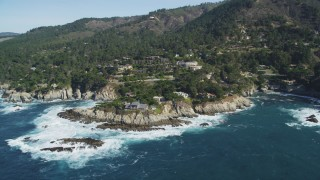 DFKSF16_049 - 5K stock footage aerial video of flying away from oceanfront mansions in Carmel, California