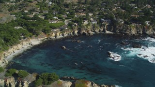 DFKSF16_051 - 5K stock footage aerial video of flying by oceanfront homes and a cove, Carmel, California