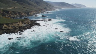 DFKSF16_056 - 5K stock footage aerial video of flying over kelp near waves crashing against coastal cliffs, Carmel, California