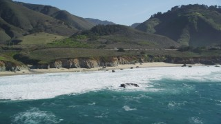 DFKSF16_062 - 5K stock footage aerial video of flying by waves crashing on small beach, Carmel, California