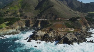 DFKSF16_065 - 5K stock footage aerial video of flying by the Highway 1 coastal road winding around the coastline, Carmel, California
