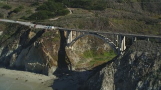 DFKSF16_068 - 5K stock footage aerial video of flying over the Rocky Creek Bridge above coastal cliffs, Carmel, California
