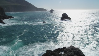 DFKSF16_071 - 5K stock footage aerial video of tilting from coastal rock formations, revealing cliffs, Big Sur, California