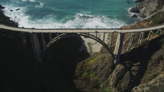 DFKSF16_074 - 5K stock footage aerial video of orbiting Bixby Creek Bridge above coastal cliffs, Big Sur, California