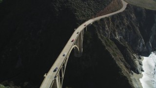 DFKSF16_075 - 5K stock footage aerial video of light traffic on the Bixby Creek Bridge above coastal cliffs, Big Sur, California
