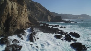 DFKSF16_077 - 5K stock footage aerial video of flying around coastal cliffs and rock formations, Big Sur, California