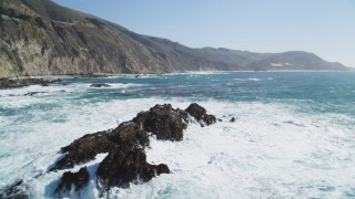DFKSF16_085 - 5K stock footage aerial video of flying by and away from rock formations near coastal cliffs, Big Sur, California