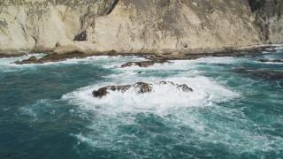 DFKSF16_086 - 5K stock footage aerial video of passing ocean rock formations near coastal cliffs, Big Sur, California