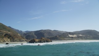 DFKSF16_087 - 5K stock footage aerial video of tilting from ocean kelp, reveal coastal rock formations and a beach, Big Sur, California