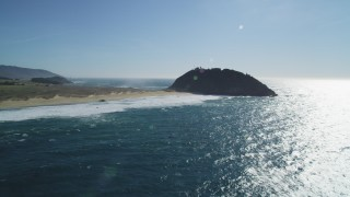 DFKSF16_088 - 5K stock footage aerial video of tilting up from ocean revealing Point Sur Light Station, Big Sur, California