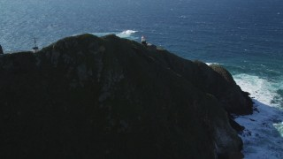 DFKSF16_092 - 5K stock footage aerial video of approaching the Point Sur Light Station, above the coastline, Big Sur, California