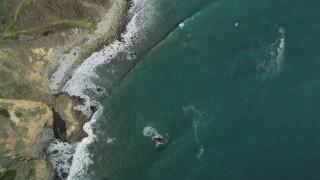 DFKSF16_112 - 5K stock footage aerial video of a bird's eye view of coastal cliffs, revealing rocky beach, Big Sur, California