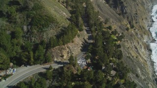 DFKSF16_114 - 5K stock footage aerial video approach and fly over Highway 1 winding top coastal cliffs, Big Sur, California