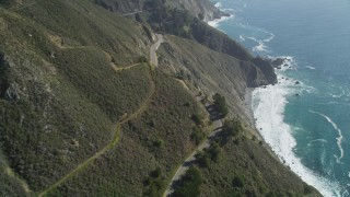 DFKSF16_115 - 5K stock footage aerial video of flying over the Highway 1 coastal road and cliffs, Big Sur, California
