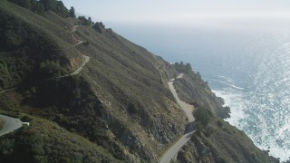 DFKSF16_118 - 5K stock footage aerial video tilt from Highway 1 atop coastal cliffs to wider ocean view, Big Sur, California
