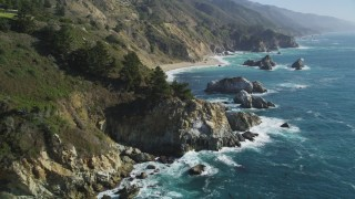 DFKSF16_120 - 5K stock footage aerial video of flying over rock formations and coastal cliffs, Big Sur, California
