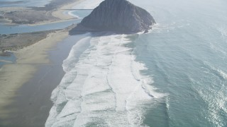 DFKSF16_154 - 5K stock footage aerial video of flying over Morro Strand Beach, revealing Morro Rock, Morro Bay, California