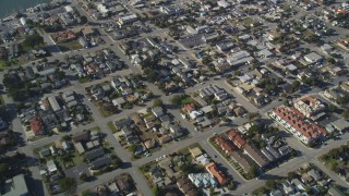 DFKSF16_157 - 5K stock footage aerial video of a reverse view of suburban neighborhoods in Morro Bay, California