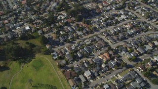 DFKSF16_158 - 5K stock footage aerial video of a reverse view of suburban homes, reveal Morro Bay Golf Course, California
