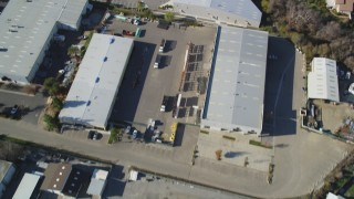 DFKSF16_161 - 5K stock footage aerial video of a reverse view of shopping centers and suburban homes in San Luis Obispo, California
